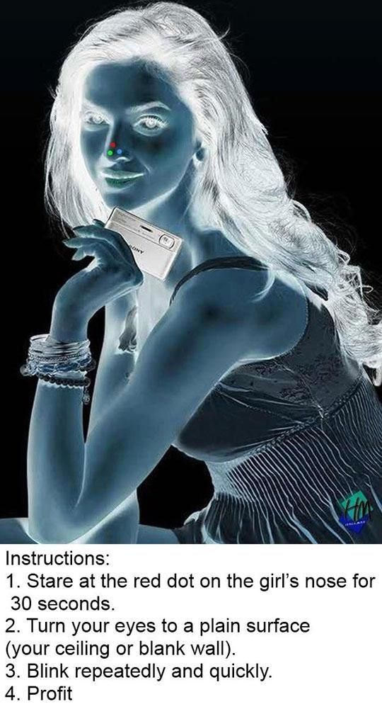 Colorful optical illusion. Stare at the red dot on her nose for thirty seconds, then look at a clear light colored wall