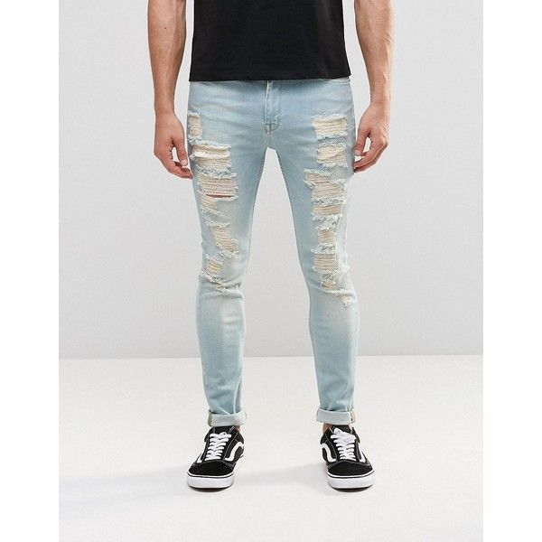 ASOS Super Skinny Jeans With Extreme Rips In Mid Wash Blue (2,530 DOP) ❤ liked on Polyvore featuring men's fashion, men's clothing, men's jeans, blue, mens skinny jeans, asos mens jeans, mens ripped skinny jeans, mens distressed jeans and mens distressed skinny jeans