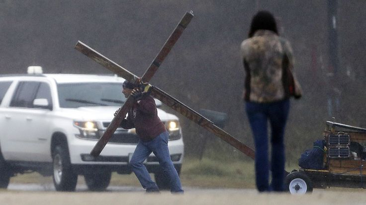 Members of the First Baptist Church of Sutherland Springs, Texas held their first Sunday service following last Sunday's mass shooting there.  In an emotional sermon, Pastor Frank Pomeroy spoke of the 26 killed on Nov. 5., including his 14-year-old daughter, invoking a sense of both personal and communal loss. (Jessie Roselyn. 11/12/2017)