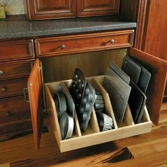 Bakeware storage can be placed under the double ovens wall