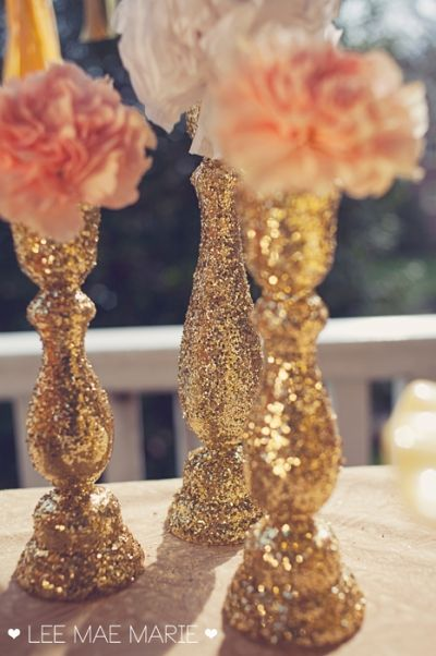 DIY: Purchase wooden candlesticks from a craft-store then coat with glitter