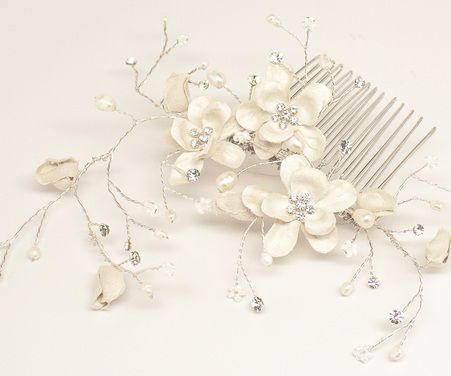 Ivory silk flower bridal hair comb vine accented with rhinestones, pearls and crystals in a low bun bridal updo hairstyle.  Bohemian flower hair comb by Hair Comes the Bride.