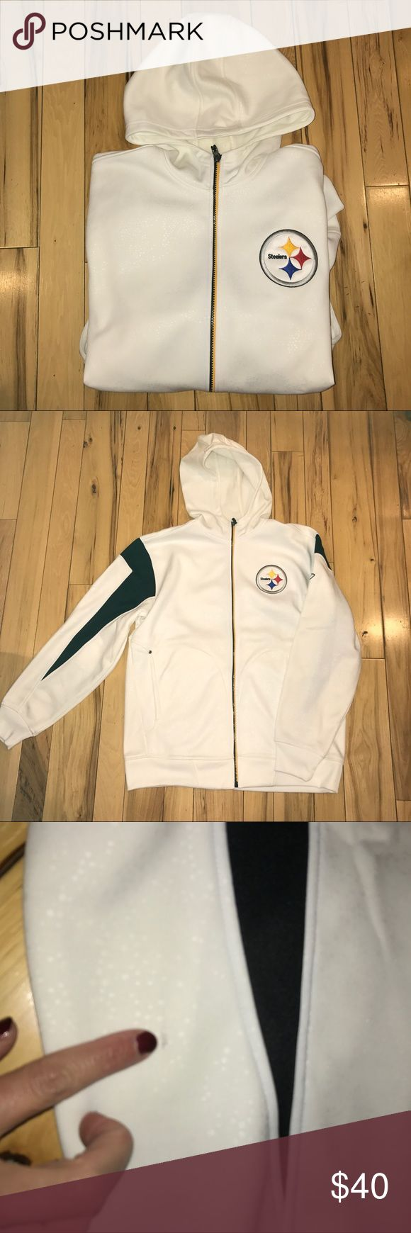 Steelers Hoodie Worn once! Reebok Onfield hoodie. Full zip. NFL patch on arm. White with reflective like detail. See photos. Smoke free home. Small mark on arm (see pic) but could probably come out in wash. Smoke free home. Shirts Sweatshirts & Hoodies
