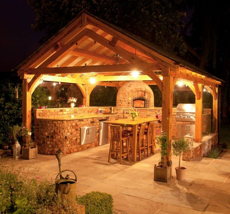 Romantic Outdoor Kitchens Ideas In Wooden Gazebo At Night With Lovely Lights And Rustic Brick Cabinet Also Wooden Dining Set Idea - Use J/K to navigate to previous and next images