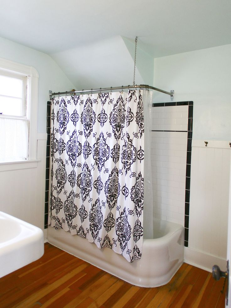 Use decorative sheets, fabrics, and even window treatment material to beautify your shower area. Hang fabric from the ceiling to add visual height and make your bathroom look and feel larger. Add colorful wallpaper, and decorative bath accessories to complement your bathroom shower curtain