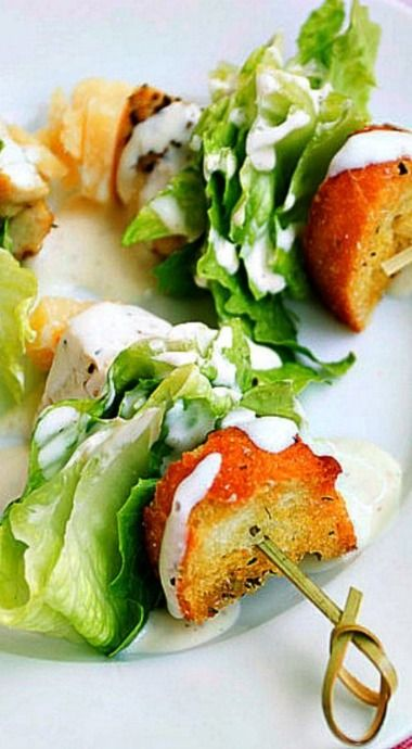 Chicken Caesar Salad on a Stick~ Thread a crouton, romaine lettuce wedge, chicken cube, and Parmesan cheese cube onto each toothpick. Arrange on a serving platter and drizzle Caesar salad dressing over each.