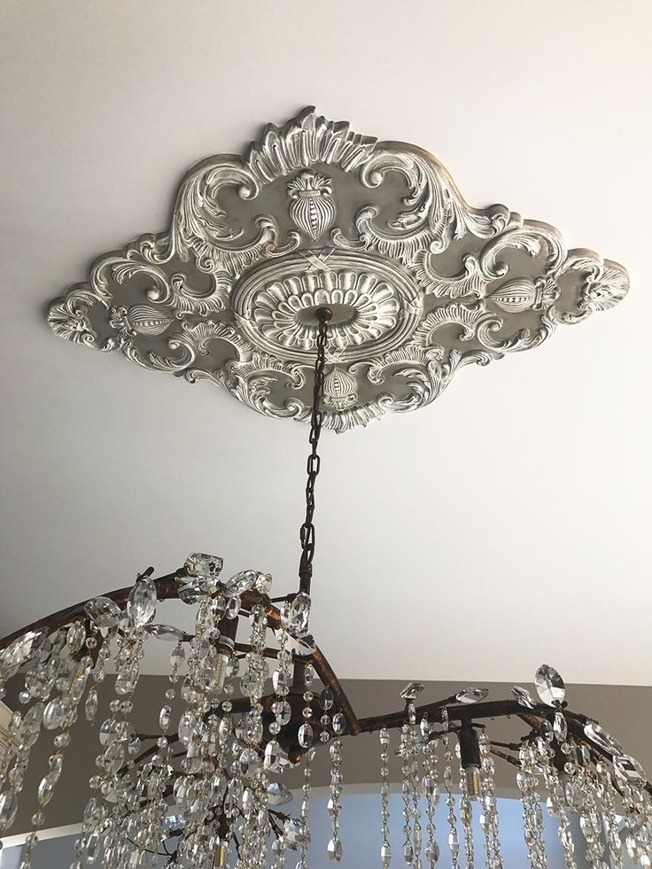 Beautiful Ekena Millwork Ceiling Medallion With A Chandelier