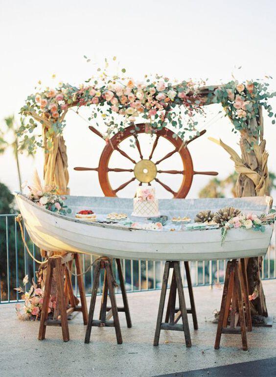 rustic beachy dessert bar and wedding backdrop / http://www.deerpearlflowers.com/rustic-canoe-wedding-ideas/