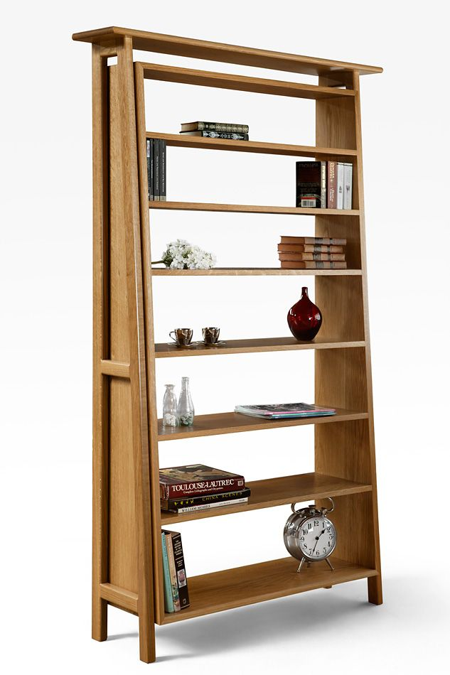 Solid American Oak bookcase with Mid Century influence. The hand rubbed oil finish is great on the American Oak.