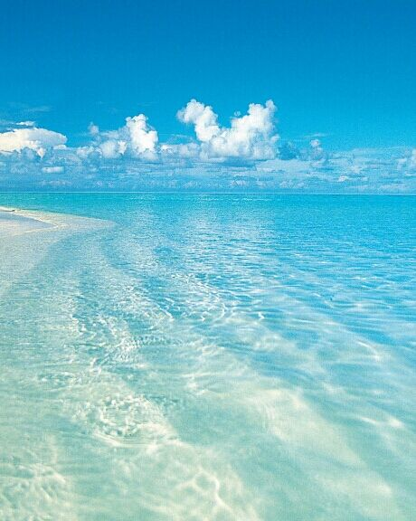 Just the sun...the beach...the blue crystal clear sea water...the blue sky and the clouds...   nautical coasts