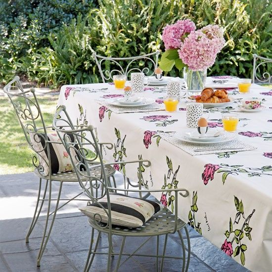 Floral garden table This rose print tablecloth creates a striking and nostalgic look. Black accents in the fabric and crockery add a modern twist. Tablecloth Beaudesert Similar chairs and table  Marston & Langinger Cushions Clarke & Clarke  Read more at http://www.housetohome.co.uk/garden/picture/floral-garden-table-1#MTgyPoD21eRUmiXp.99
