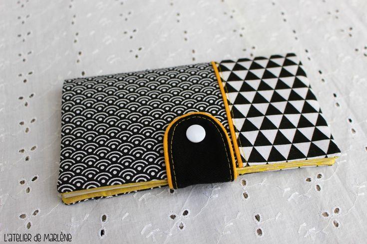 porte chéquier noir et blanc géométrique