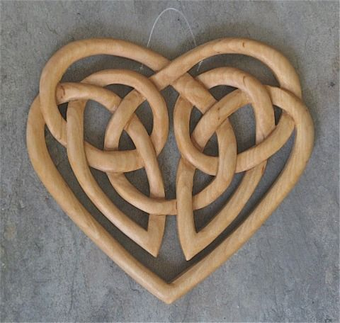 I first carved this traditional design for person facing heart surgery. The 'mirrored' knot motif serves as a reminder that both friends and family hold the person's heart in prayer and support. It is carved on both sides as a reminder of those who are both near and far. It is 5 x 5.5 inches. It is made of white birch and finished with tung oil. Celtic Heart: $75