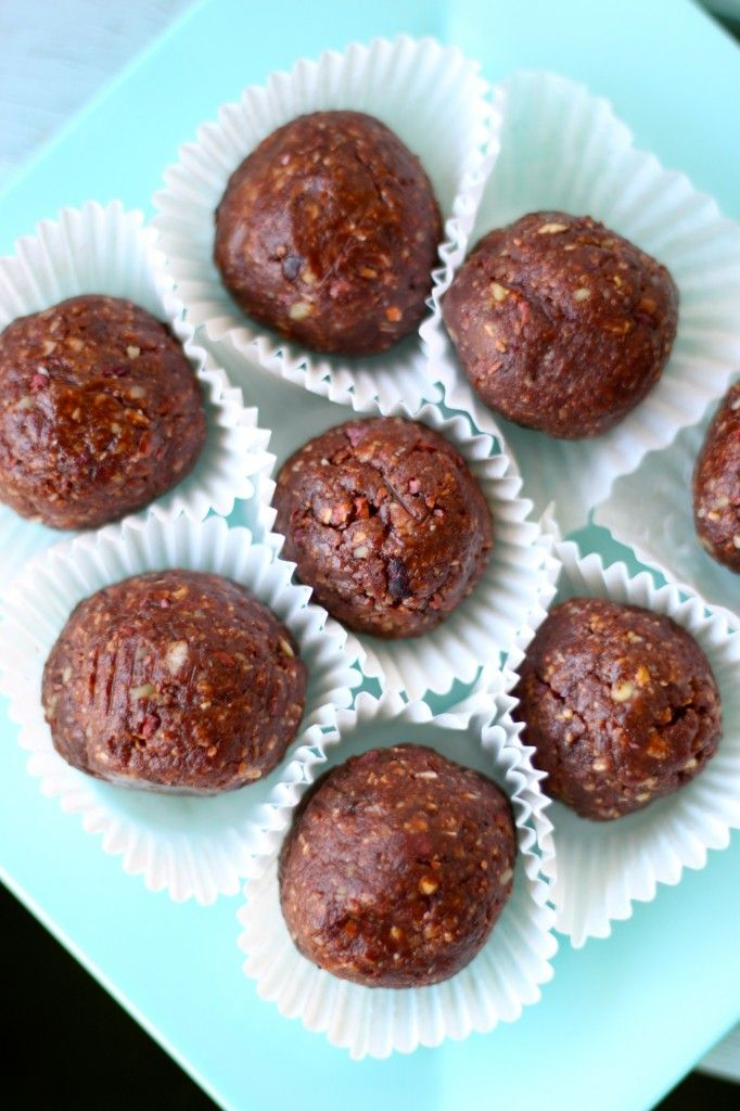 No Bake Cookie Balls made with cashews, walnuts, raw cocoa, almond butter, unsweetened coconut, oats, cocoa nibs, dried apricots, vanilla, honey and maple syrup