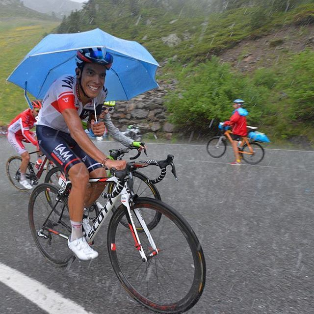 Jarlinson Pantano tries to keep dry and protect himself from the hail stones stage 9 TDF2016