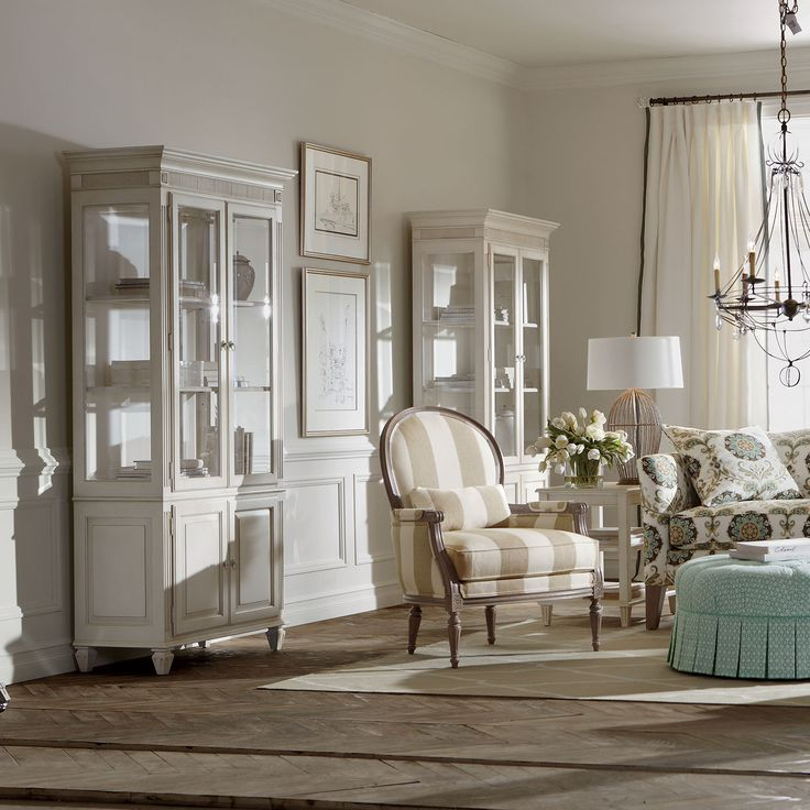 """Ethan Allen Pièrre Curio Cabinet collection: Maison by Ethan Allen 38"""" w x 80"""" h x 18"""" d Item# 379209 $2,249.00 Upper area features beveled glass door fronts and side panels, two adjustable wood-framed glass shelves with plate groove     Adjustable shelf behind lower doors"""