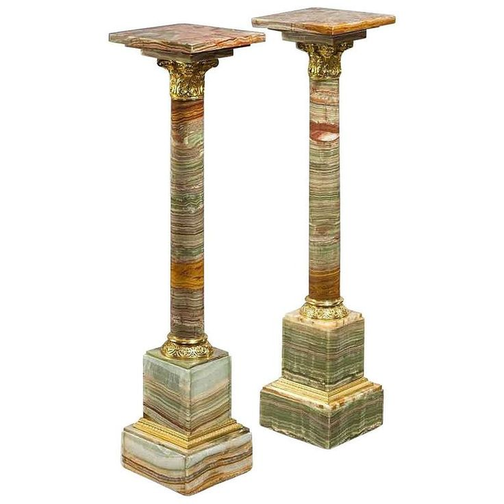 A pair of amber coloured African onyx columns | From a unique collection of…