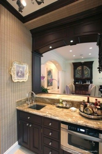 Wet Bar Area With Built In Microwave And Sink With Dark