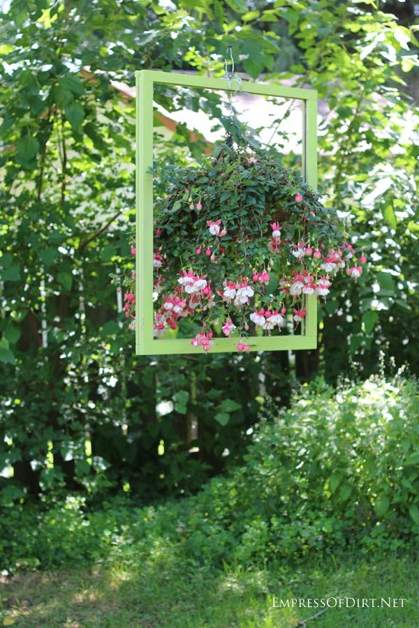 as a famous empress of dirt once said a bare fence is an outdoor garden art gallery waiting to happen and these ideas should give you lots of ideas for