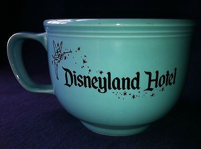 Fiesta® Dinnerware Turquoise Disneyland Hotel Stromboli's Ristorante JumboMug. Made by Homer Laughlin China Company. The mug features the lettering, 'Disneyland Hotel' along with the classic Disney Tinkerbell  logo on one side; and the lettering, 'Stromboli's Ristorante' on the reverse side | WorthPoint