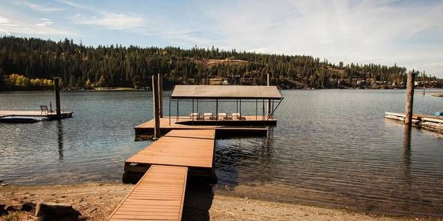 Here's a lovingly cared for home with 69 feet of lakefront on Lake Coeur d'Alene's quiet Neachen Bay. Spend summers on your private beach with fantastic southwestern exposure. The dock has a covered boat slip. It's easily accessible along the beautiful Lake Coeur d'Alene Scenic Byway, and just 20 minutes from the action in downtown Coeur d'Alene. This updated cabin has a vaulted wood paneled ceiling, a kitchen island, pantry and skylight. Big windows frame the lake view and fill the h...