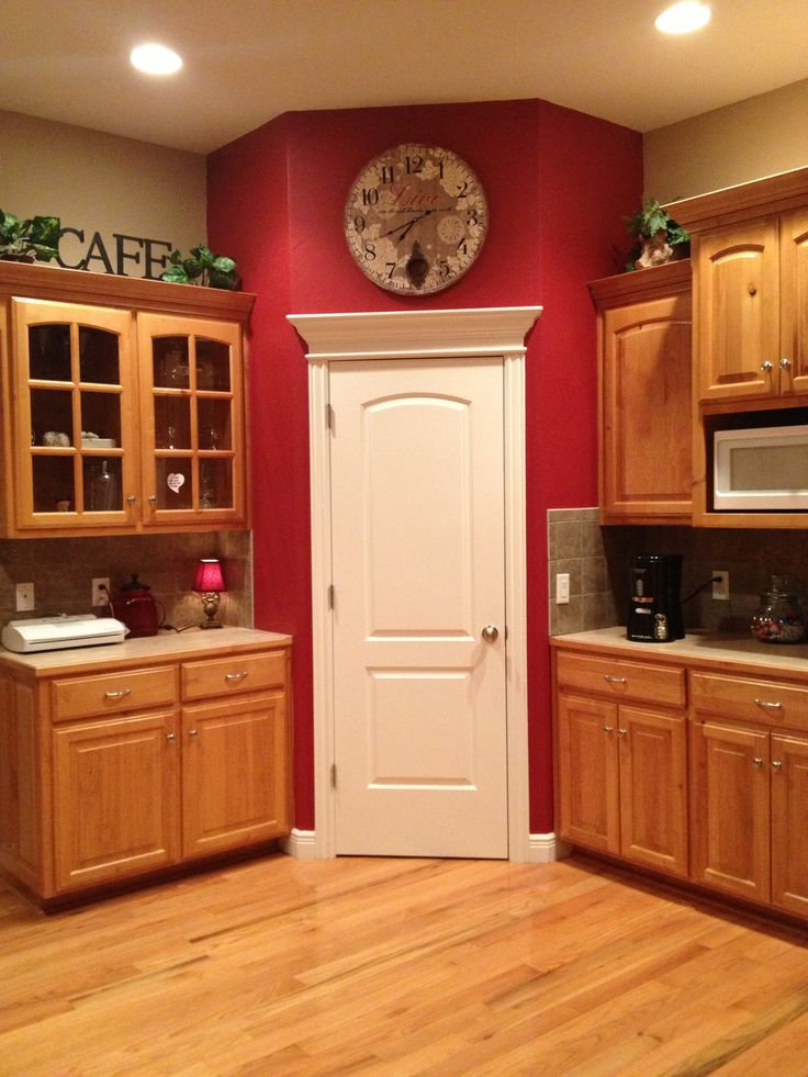 If there were an oven under that microwave this could be my kitchen!  I love the accent paint idea.