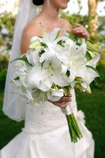 white casablanca lillies and red roses wedding bouquet | white lily bouquet