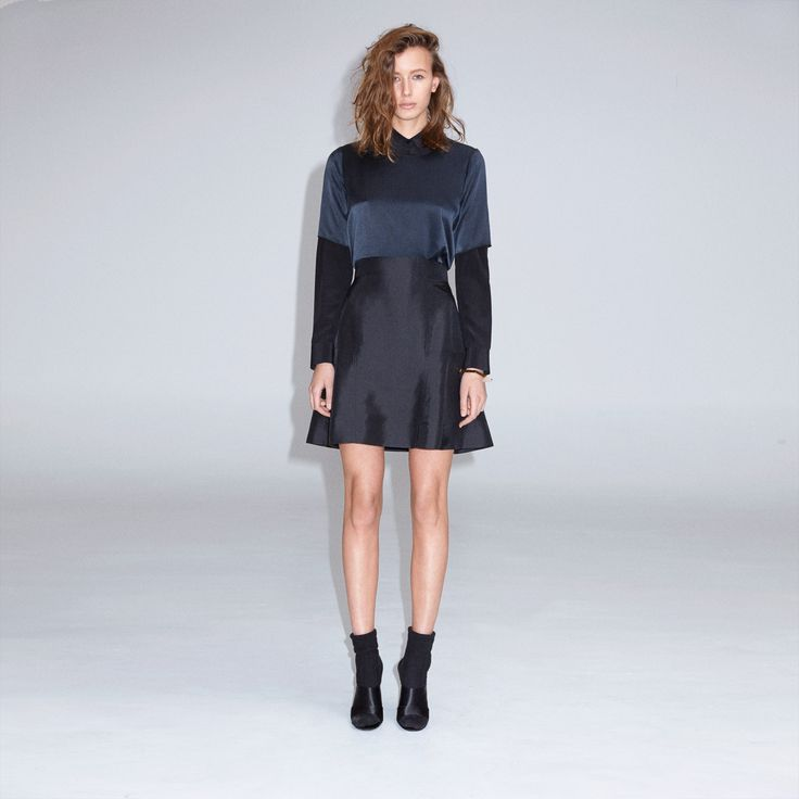 FWSS Make You Mine is a high-waist, flared mini skirt with cut and sewn panels in delicate silk.