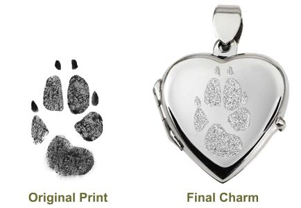 Soooooo cute!!   Send an ink print of a paw or nose and have it etched into a sterling silver pendant, ring, or other jewelry. This site also has other memorial objects such as urns and headstones. - Memorial Gallery Pets