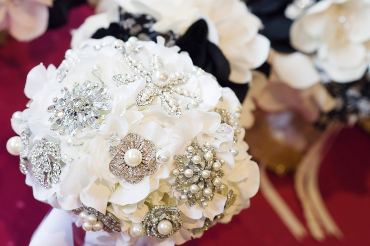 I LOVE my brooch bouquet and the girls fabric bouquet.... and the dolls lolly pop bouquets. xx