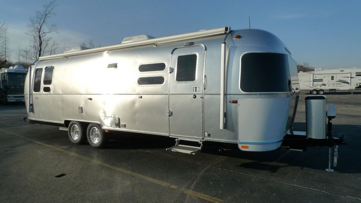 "CHARMING RV FOR A CAREFREE LIFE!!!  2017 Airstream International Serenity 30 End your days by snuggling up on the pillow top memory foam mattress and putting in a movie on the Blu-Ray player for crystal clear, high-quality entertainment! When you wake in this 30' 11"" long, 6382 lb. RV you can brew up a pot of coffee and start planning your outdoor adventures for the day!  Give our Airstream International Serenity expert Cynthia Jahs a call 734-693-1516 for pricing and more information."