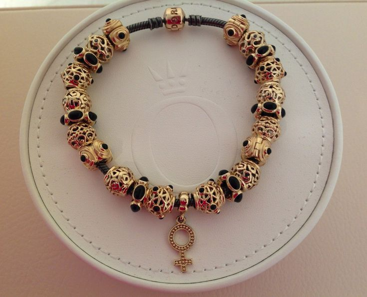 Pandora Gold and Black Onyx Bracelet... Love the Contrast of the Black and the Gold. Just Stunning......