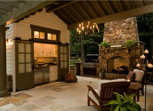 Hiding Out An outdoor kitchen doesn't need to leave all its features exposed to the elements! Positioning an enclosed kitchenette off your outdoor living space shelters appliances and makes room for even more cabinet storage for all your entertaining needs.