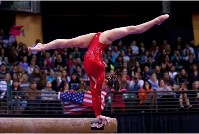 Katelyn Ohashi holds a handstand as part of her balance beam mount at the 2012 Kellogg's Pacific Rim gymnastics competition.  She went on to win the junior all-around title for the U.S.  It's too bad we have to wait until 2016 to see her shoot for the Olympics.  (Photo by John Cheng)