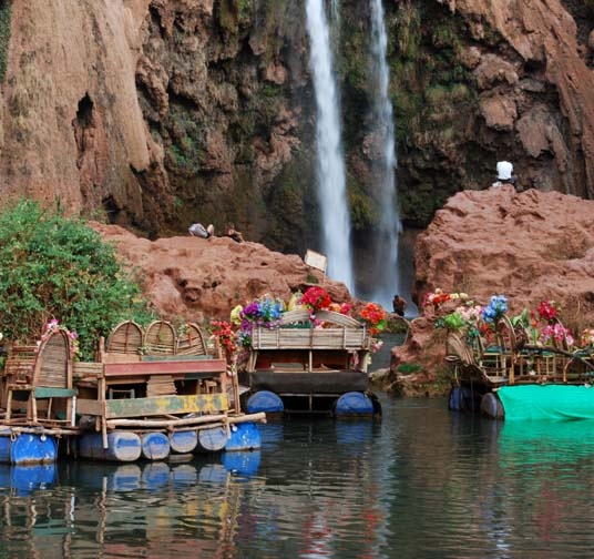 Cascades des Ouzoudes, Morroco. The waterfalls a little over an hour from Marrakech. Flower-clad boats for hire.