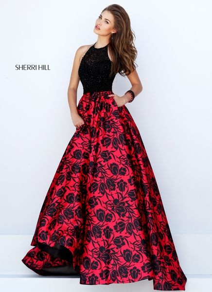 # 50245 Easy to wear and oh-so-flattering halter bodice in black duchess satin is perfect with our exclusive art deco inspired red and black print ball gown skirt. Notice the pockets? Color: black/red