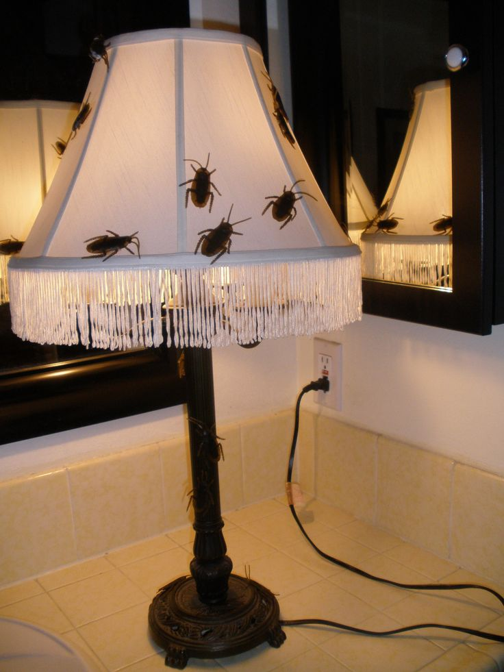 New haunting decor lamp for 2014 Halloween. $5 thrift store lamp, Spirit Halloween realistic looking cockroaches.(Halloween Forum member punkineater)