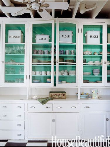 White cabinets glass doors turquoise or Tiffany blue painted interior- love this