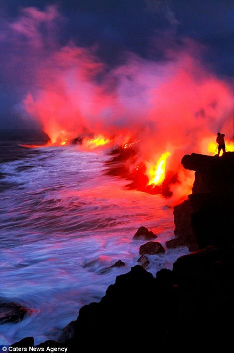 Hot lava flows into the sea in Volcanoes National Park, The Big Island, Hawaii. #lava