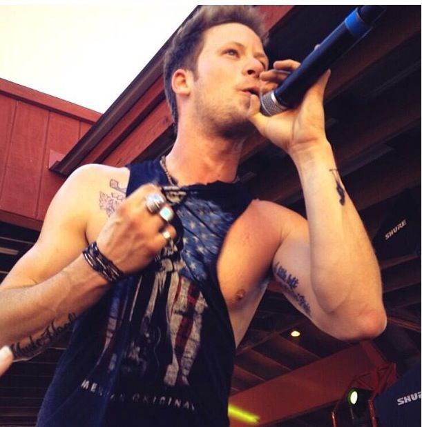 OH MY GOD. THE NIP SLIP. AND THE TATTOOS. I just....he's just...sploosh.  Brian Kelley of Florida Georgia Line