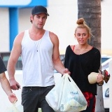 Miley Cyrus and fiancé Liam Hemsworth keep it real, stopping by a Marshalls store in Sherman Oaks, CA on 7/2/12