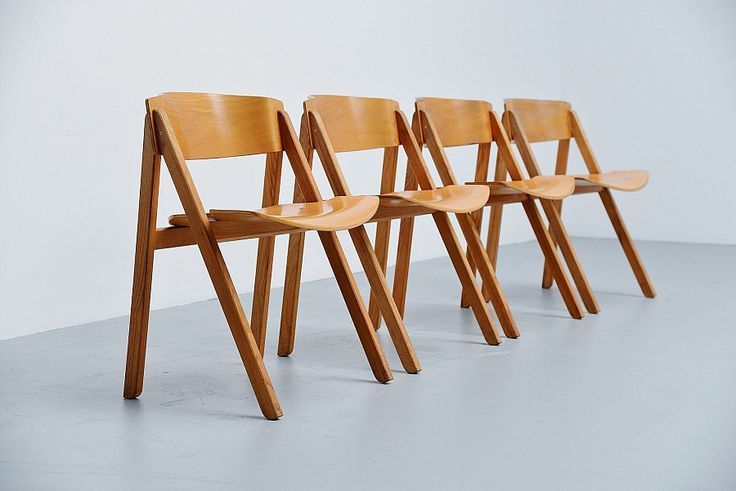 Rare set of 4 trestle dining chairs designed by Victor Bernt and manufactured by Soren Willadsen, Denmark 1972. These chairs were originally designed for the Olympics in Munich in 1972. The chairs are made of birch teak plywood and have a very nice comfortable shape. They have a nice patina from age and usage. But there are no big damages to them. - See more at: http://massmoderndesign.com/gallery-detail/victor-bernt-dining-chairs-soren-willadsen-denmark-1972#sthash.xYC3YCaV.dpuf
