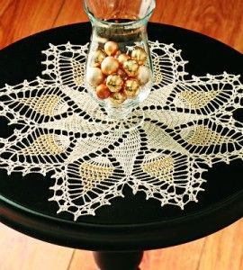 Gold Crochet Table Topper: All year long, this glitzy gold crocheted design will look lovely in your home. countrywomanmagazine.com