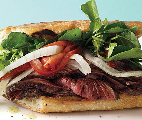 Grilled Steak Sandwiches with Marinated Watercress, Onion, and Tomato Salad Recipe  at Epicurious.com