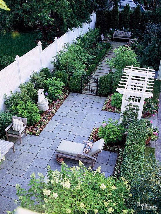 Plants and shrubs soften this patio's design.