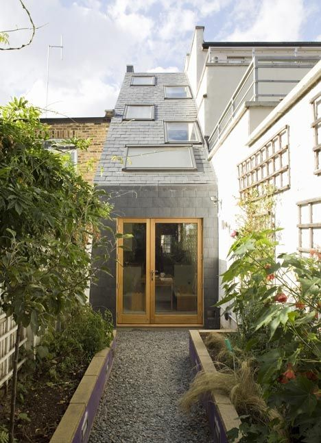 British architects Alma-nac redid this cramped and dingy terraced London house that measures only 2.3 meters (7.5 feet) wide -- built over what was once a lane between two houses. Skinny makeover lights up 7-foot wide house : TreeHugger | Tiny Homes