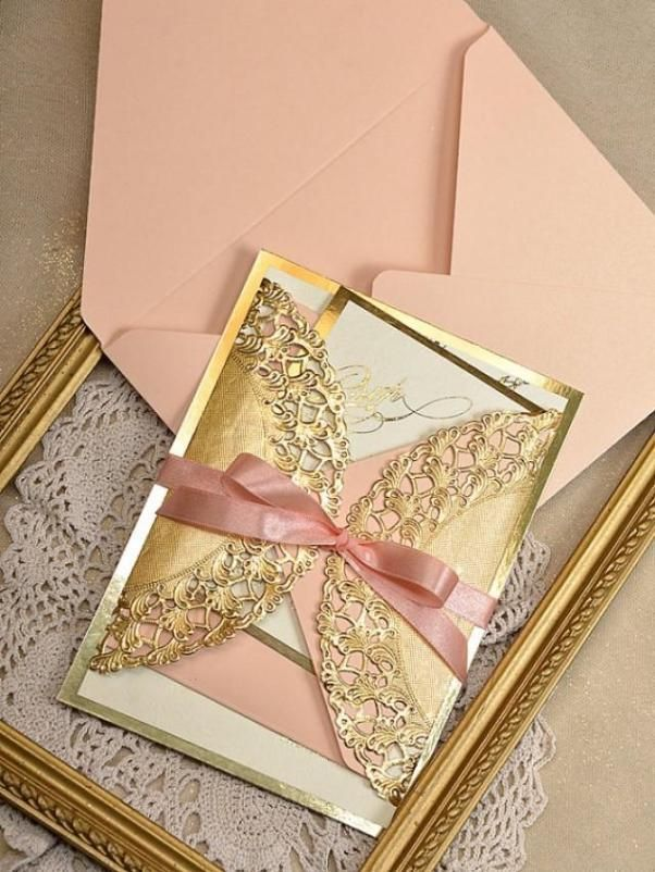 gold and pink wedding invitations with lace envelopes
