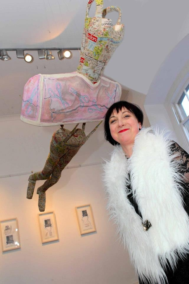 "Artist Kathleen Delaney underneath one of her exhibits ""Flying Above, Looking Deep"" which is part of her L'Armoire Exhibition which opened on Friday last and runs from Friday 5th May-Wednesday 15th May at Garter Lane Arts Centre"