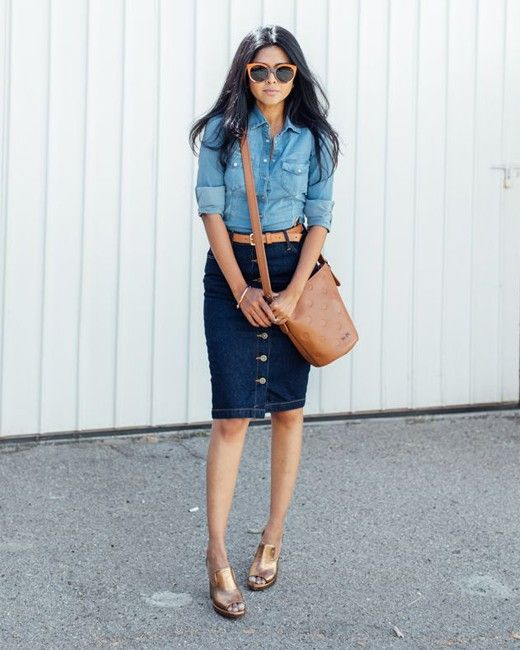Try a more modern version of the Canadian tuxedo: a chambray shirt tucked into a '60s button-front midi skirt.