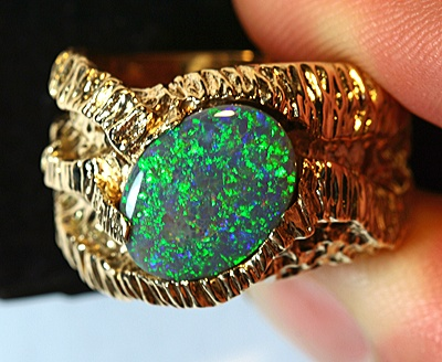 Estate Solid Black Opal 9k Solid Yellow Gold Ring Size 11.25  http://www.blackopalworld.com/product_info.php/pName/estate-solid-black-opal-9k-solid-yellow-gold-heavy-ring-mens/cName/opal-jewellery-opal-rings